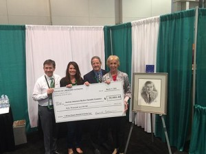 Jim HInes, Holly Hampton, David Cohen and Dianne Oltmann reveal the newly formed J. Richard Oltmann Memorial Scholarship Fund.